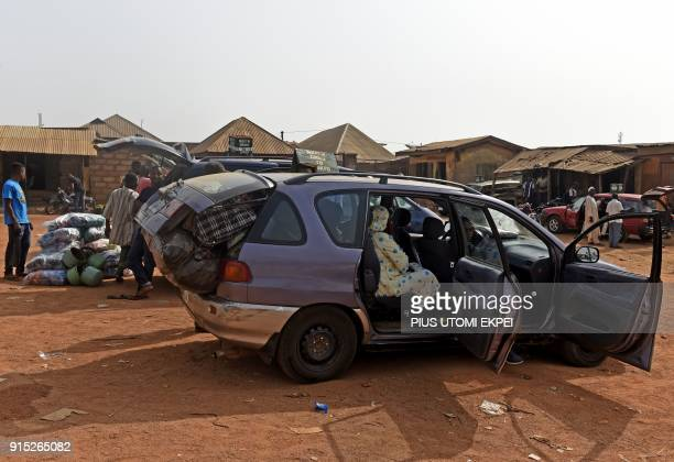 This photograph taken on February 3 shows minibuses as they wait for passengers at Gboko bus station in the restive Benue State northcentral Nigeria...