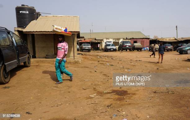 This photograph taken on February 3 shows pedestrians walking through Gboko Bus Station in the restive Benue State northcentral Nigeria In the heart...