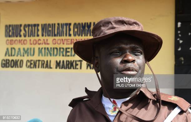 This photograph taken on February 3 shows the Head of The Vigilante Liaison Office Comrade Tosin Ibitoye as he speaks about violence that led to...