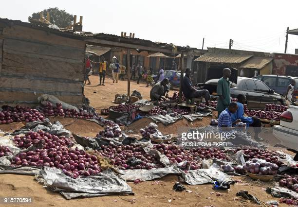 This photograph taken on February 3 shows vendors displaying onions as they wait for customers at Gboko Bus Station in the restive Benue State...