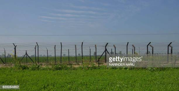 This photograph taken on February 7 shows a general view of the IndiaPakistan border fence in the village of Mahawa some 40kms from Amritsar / AFP /...