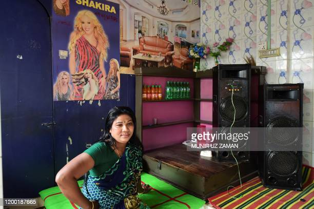 This photograph taken on February 8 2020 shows a sex worker posing for photos inside a brothel in Daulatdia in Rajbari District 110 kms west of Dhaka...