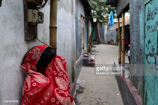 This photograph taken on February 8 2020 shows a sex worker standing in front of a brothel in Daulatdia in Rajbari District 110 kms west of Dhaka...