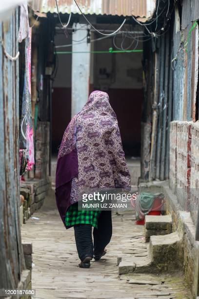 This photograph taken on February 8 2020 shows a sex worker walking through a brothel area in Daulatdia in Rajbari District 110 kms west of Dhaka...