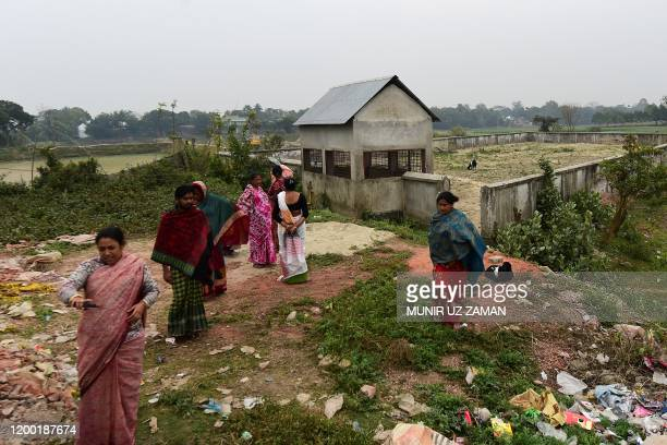 This photograph taken on February 8 2020 shows Jhumur Begum who heads a sex workers group walking with other members next to a graveyard used for the...