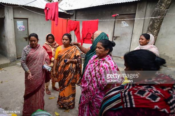 This photograph taken on February 8 2020 shows Jhumur Begum who heads a sex workers group visiting a brothel area in Daulatdia in Rajbari District...