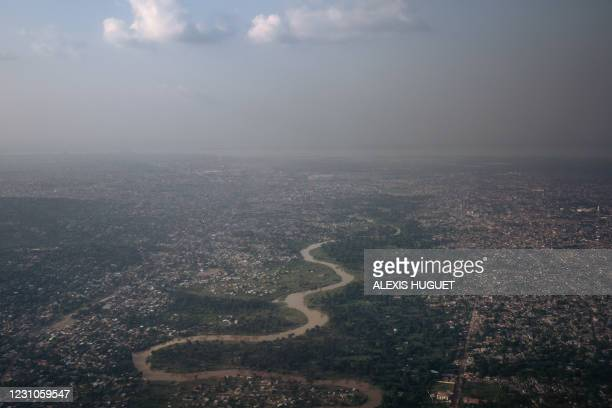 This photograph, taken on February 8, 2021 shows an aerial view of Kinshasa at sunset, capital city of the Democratic Republic of Congo.
