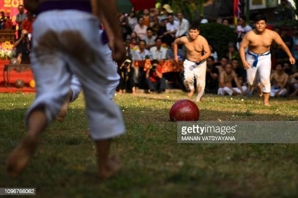 This photograph taken on February 9 2019 shows the prized jackfruit wooden ball in the middle of the pitch during the traditional 'Vat Cau' or ball...
