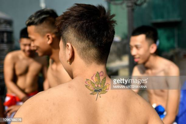 This photograph taken on February 9 2019 shows Vietnamese men waiting for the start of the traditional 'Vat Cau' or ball wrestling festival on the...
