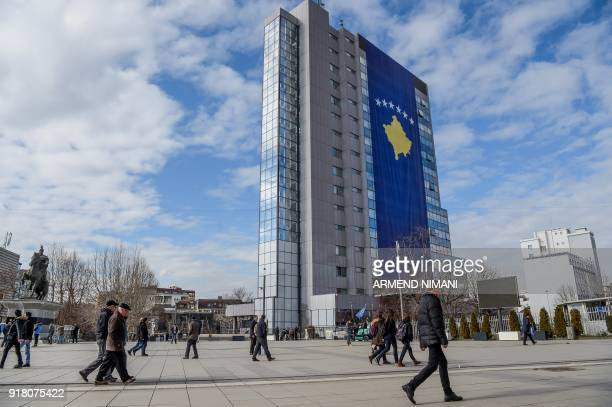 This photograph taken on February 9 shows a giant Kosovo flag placed on the government building in Pristina Kosovo which celebrates the tenth...