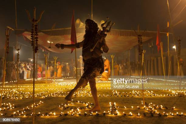 TOPSHOT This photograph taken on January 15 2018 shows holy man Shiv Yogi Moni Swami performing a ritual at his camp at Sangam the confluence of the...