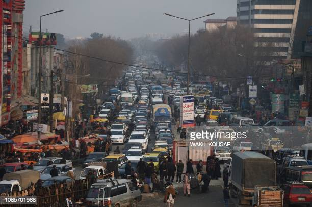 This photograph taken on January 16 shows heavy traffic along a road in Kote Sangi area amid heavy smog conditions in Afghanistan's capital Kabul...