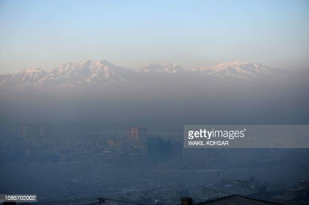 This photograph taken on January 17 shows a general view of residential areas amid heavy smog conditions in Afghanistan's capital Kabul. - Kabul...