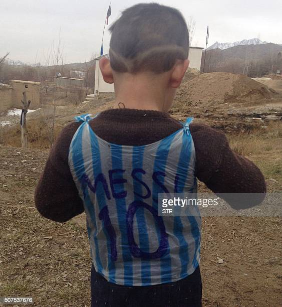 This photograph taken on January 24 2016 and provided by the family of Afghan boy and Lionel Messi fan Murtaza Ahmadi shows him wearing a plastic bag...