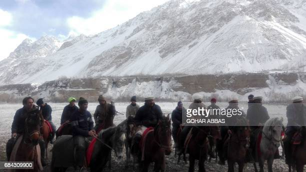 This photograph taken on January 27 Pakistani horsemen prepare to compete for a cattle carcass during a game of the traditional sport of Buzkashi in...
