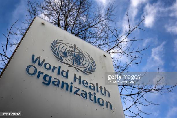 This photograph taken on January 29, 2021 shows a sign of the World Health Organization at the entrance of their headquarters in Geneva amid the...
