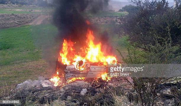 This photograph taken on January 3 shows a burning passenger van after the explosion of a compressed natural gas cylinder in northwestern Karak...