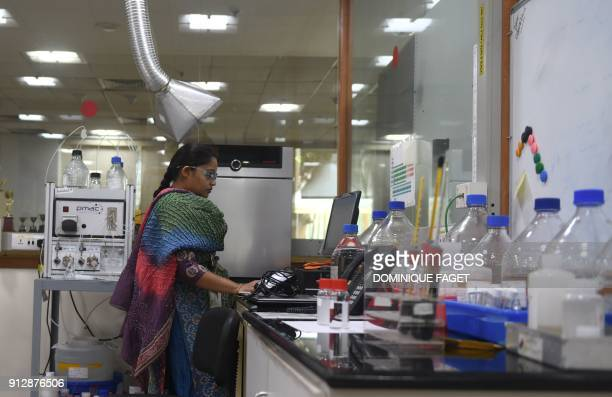 This photograph taken on January 30 2018 shows an Indian engineer working in the laboratory of Suez Water Technologies and Solutions in Bangalore...
