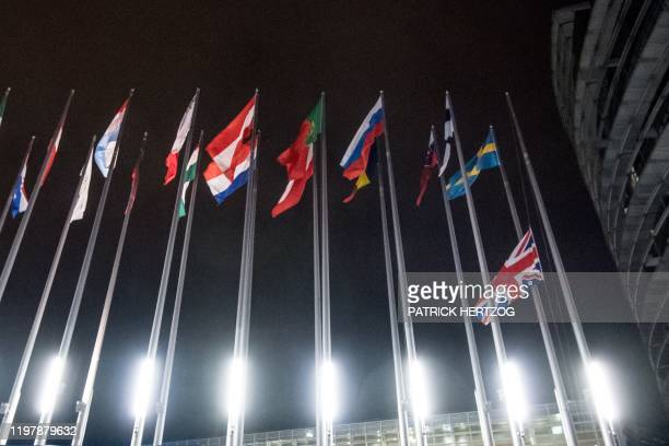 This photograph taken on January 31 shows a Union flag from the United Kingdom Representation as it is lowered from a flagpole at The European...