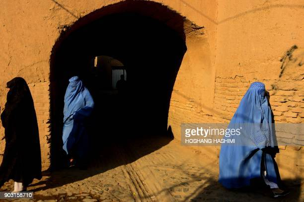TOPSHOT This photograph taken on January 9 2018 shows burqaclad Afghan women walking in the old part of Herat / AFP PHOTO / HOSHANG HASHIMI