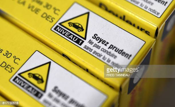 This photograph taken on July 18 shows a warning about driving on packets of painkilling pills which contain codeine in a pharmacy in Quimper western...