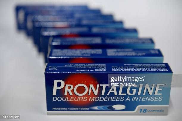 This photograph taken on July 18 shows packets of painkilling pills which contain codeine in a pharmacy in Quimper western France In France...