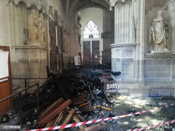 TOPSHOT This photograph taken on July 18 shows the remains of the burnt organ after falling from the 1st floor during a fire inside the...