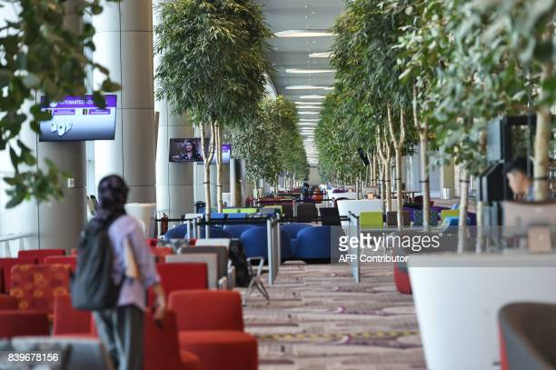 This photograph taken on July 25 2017 shows a view of the waitng zone before passengers board their flights at the newly built Changi airport...