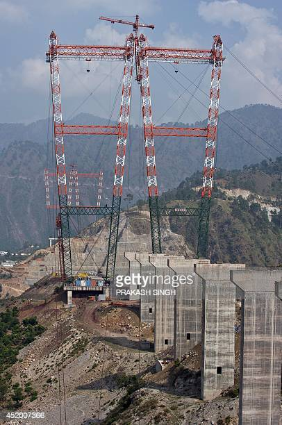 This photograph taken on July 5 2014 shows a general view of the site of the underconstruction world's highest railway bridge over the Chenab river...