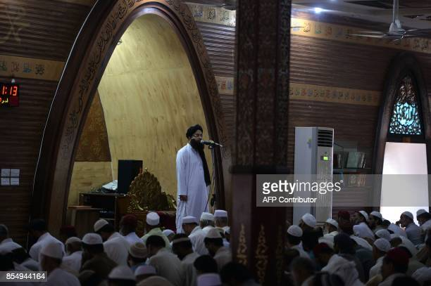 This photograph taken on July 7 shows chief cleric Amir Siddiqi delivering a sermon during Friday prayers at the Red Mosque in Islamabad during...