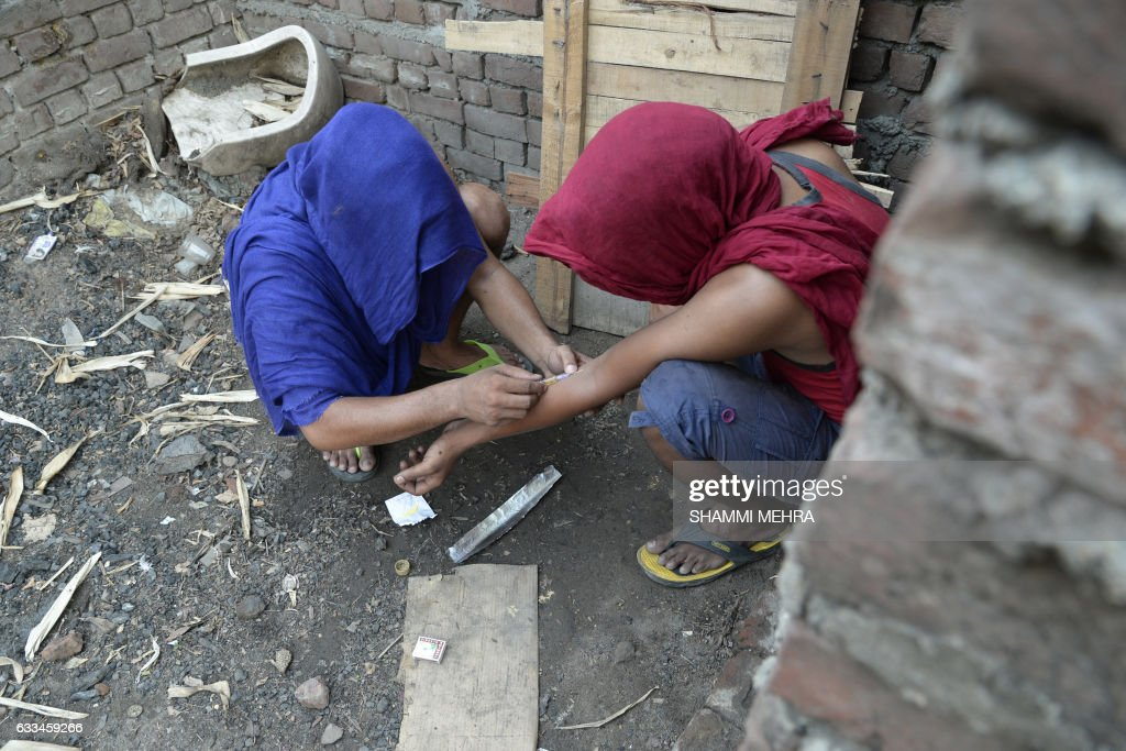 This photograph taken on June 15 shows young Indian drug addicts using heroin in an abandoned building in Jalandhar Opium addict Rajendar usually has.