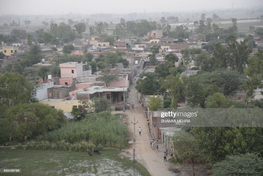 This photograph taken on June 16 shows an aerial view of the village of Boot in Kapurthala District some 60kms northwest of Jalandhar Opium addict...