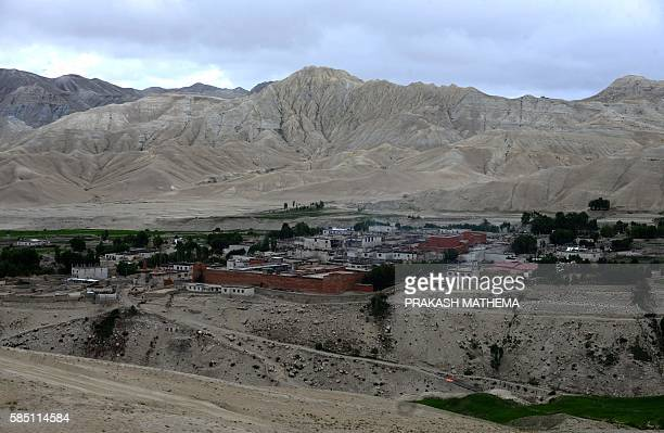 This photograph taken on June 17 shows a view of the walled city monastery and stupa of Lo Manthang in Upper Mustang. Deep in the heart of a medieval...