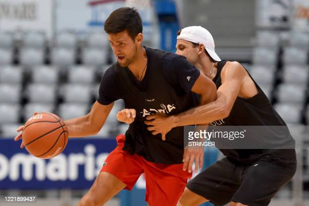 This photograph taken on June 18 shows Serbia's Novak Djokovic and Bulgaria's Grigor Dimitrov tennis players as they take part in an exhibition...
