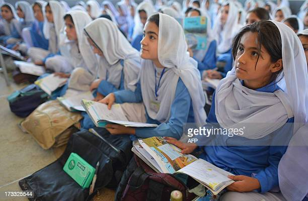 This photograph taken on June 21 2013 shows Pakistani girls attending class at a school in Mingora the main town of Swat valley When the Pakistani...