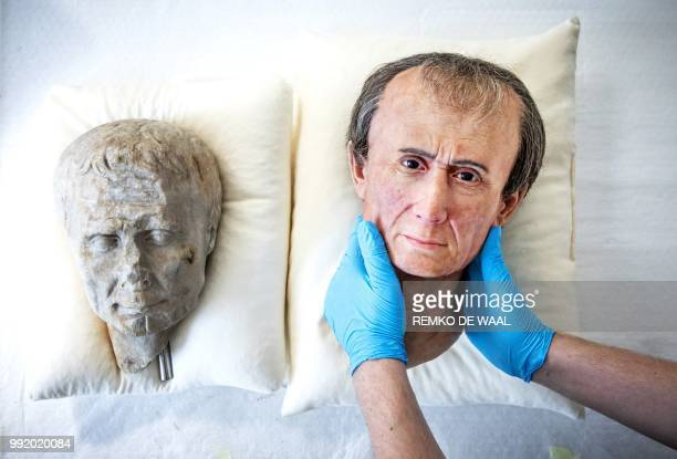 This photograph taken on June 21 shows an assistant holding a 3D reconstruction of Roman emperor and military general Julius Caesar at The National...