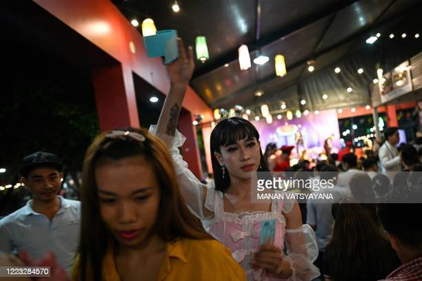"This photograph taken on June 26, 2020 shows a performer from the ""Sai Gon Tan Thoi"" LGBT troupe selling tickets during a lotto show in Binh Duong..."