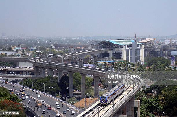 This photograph taken on June 29 shows a general view of a Chennai Metro Rail train travelling between the districts of Alandur and Koyabedu in...