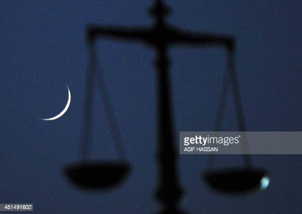 This photograph taken on June 29 shows the crescent moon signifying the start of the Islamic holy month of Ramadan in the Pakistani port city of...