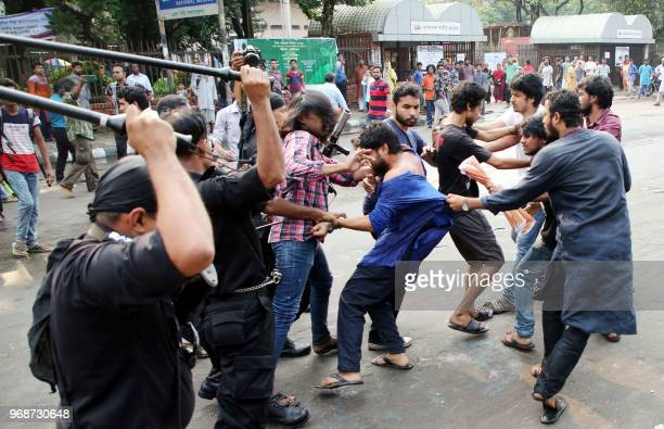 This photograph taken on June 6 shows members of the Rapid Action Battalion of the Bangladesh police batoncharging secular activists for protesting...