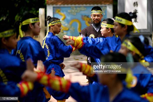 This photograph taken on June 7, 2020 shows master Nguyen Khac Phan teaching female students the centuries-old martial art of Thien Mon Dao inside...
