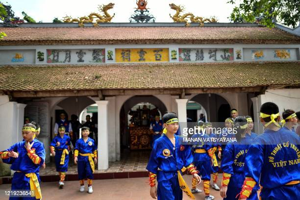 This photograph taken on June 7, 2020 shows students gathering to take part in a training class for the centuries-old martial art of Thien Mon Dao...