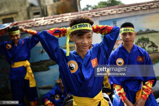 This photograph taken on June 7, 2020 shows students wearing headbands before taking part in a training class for the centuries-old martial art of...