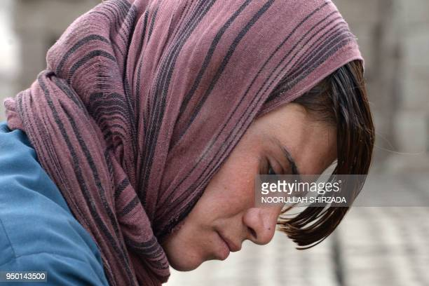 This photograph taken on March 11 2018 shows Afghan female labourer Sitara Wafadar who dresses as a male in order to support her family working at a...