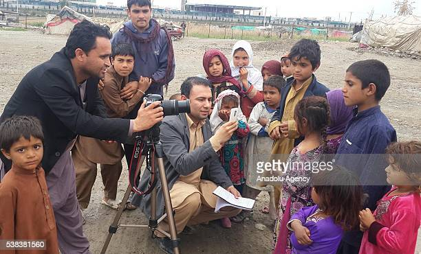 This photograph taken on March 16 2015 shows Anadolu Agency and National Public Radio interpreter Zabihullah Tamanna as he talks with Afghan refugees...