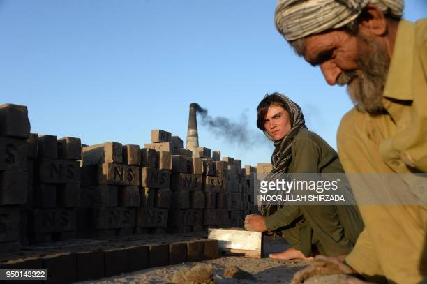 This photograph taken on March 28 2018 shows Afghan female labourer Sitara Wafadar who dresses as a male in order to support her family working at a...