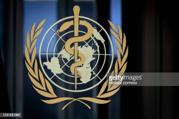 This photograph taken on March 5, 2021 shows a sign of the World Health Organization at the entrance of their headquarters in Geneva amid the...