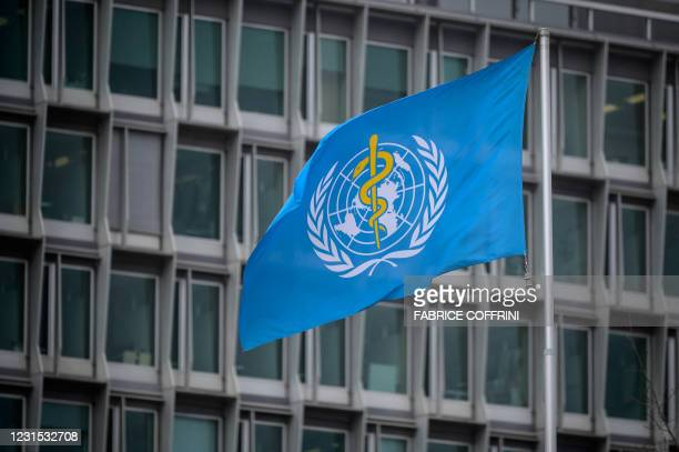 This photograph taken on March 5, 2021 shows the flag of the World Health Organization at their headquarters in Geneva amid the Covid-19 coronavirus...