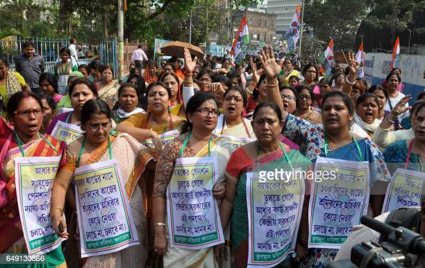 This photograph taken on March 6 2017 shows Indian activists protesting in Kolkata against the Indian government's decision to link free lunch meals...
