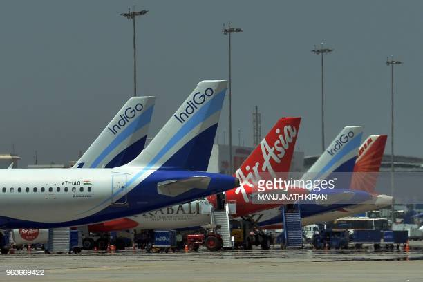 This photograph taken on March 8 2018 shows an airplane of Air Asia the lowcost airline headquartered in Malaysia parked with other airliners at...